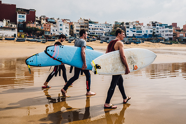 walking with surfboards
