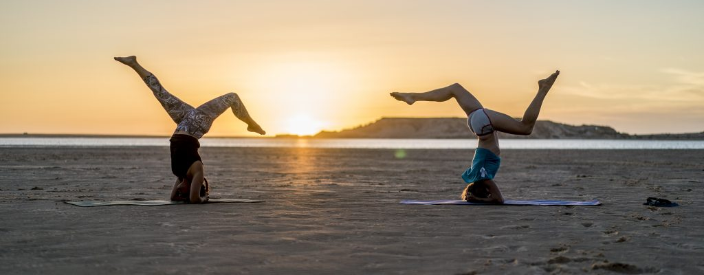 Head Stand on a sunset